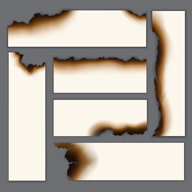 Realistische verbrande blanco vellen papier set Gratis Vector