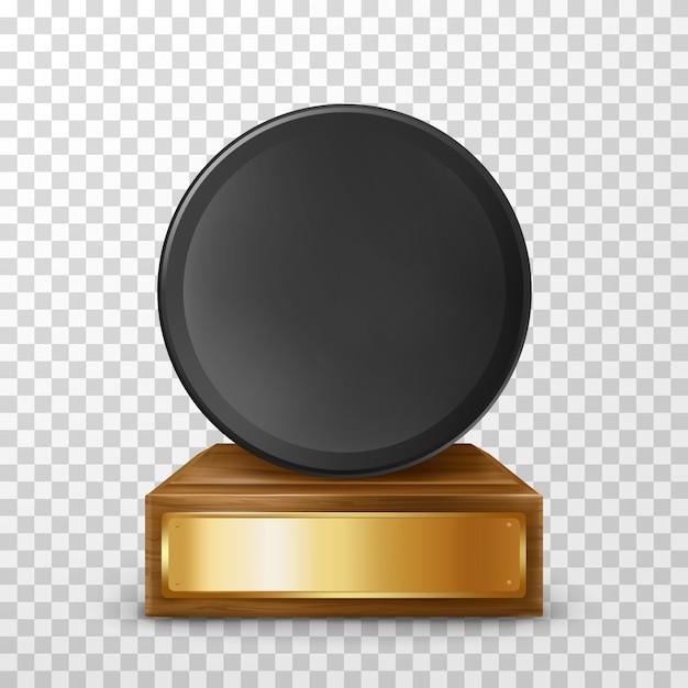 Realistische winnaar hockey puck award op voetstuk Gratis Vector