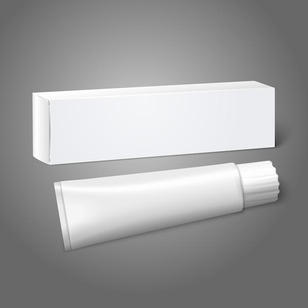 Realistische witte blanco papieren pakketdoos met buis voor langwerpige spullen - tandpasta, cosmetica, medicijnen enz. op grijze achtergrond voor en branding. Premium Vector