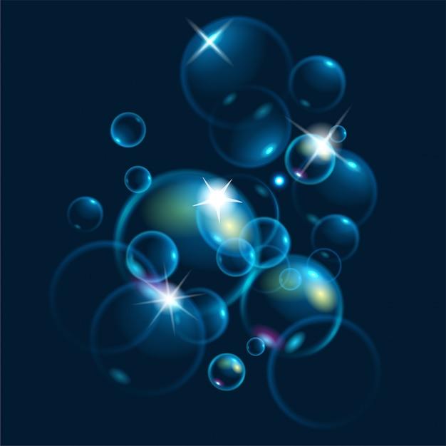 Realistische zeepbellen met regenboogbezinning. Premium Vector