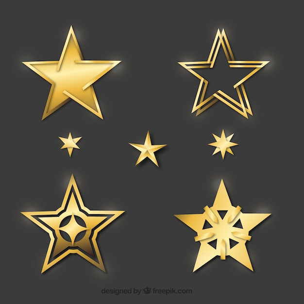 Reeks decoratieve gouden sterren Premium Vector