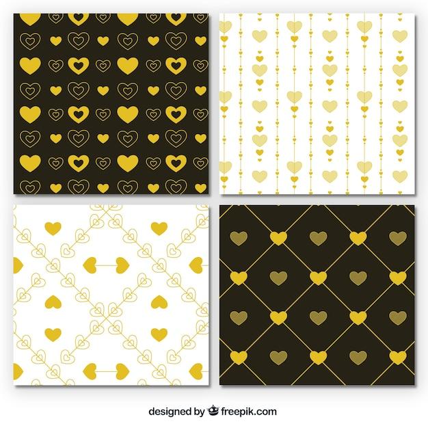Reeks gouden harten patronen Gratis Vector