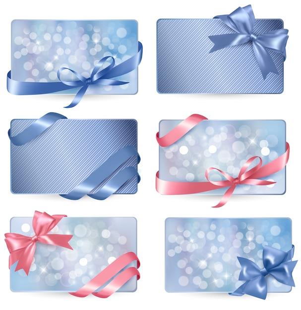 Reeks kleurrijke giftcards met giftbogen met linten Premium Vector