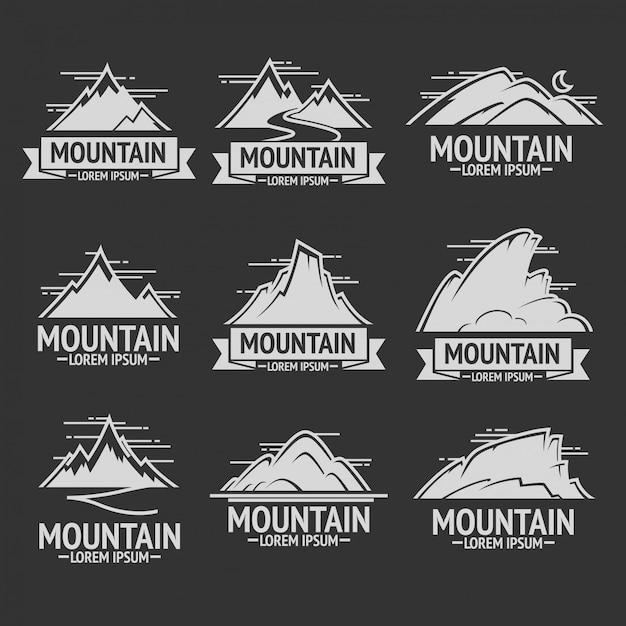 Reeks uitstekende emblemen van de bergexploratie Premium Vector