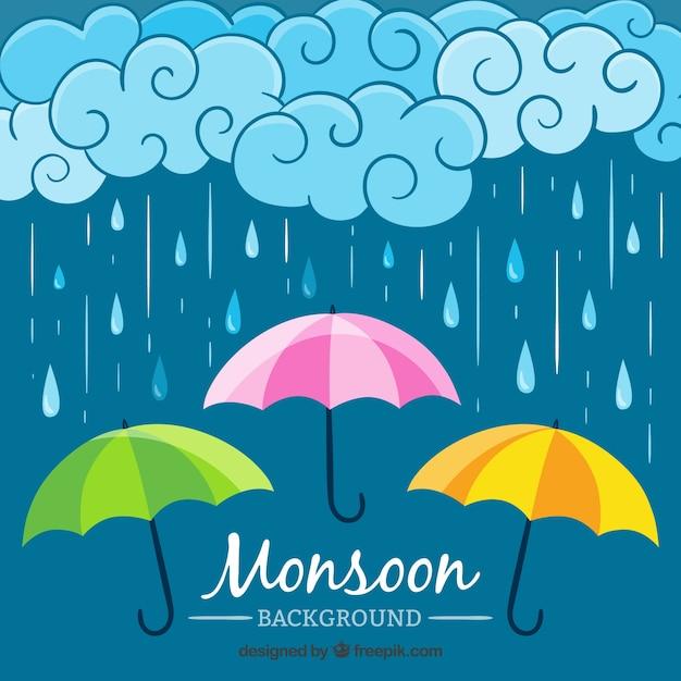 Regenachtergrond met drie kleurrijke paraplu's Gratis Vector