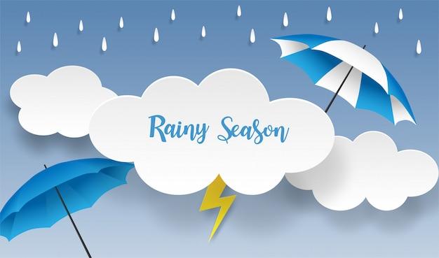 Regenseizoen. ontwerp met regendruppels, paraplu en wolken op blauwe achtergrond. vector. Premium Vector