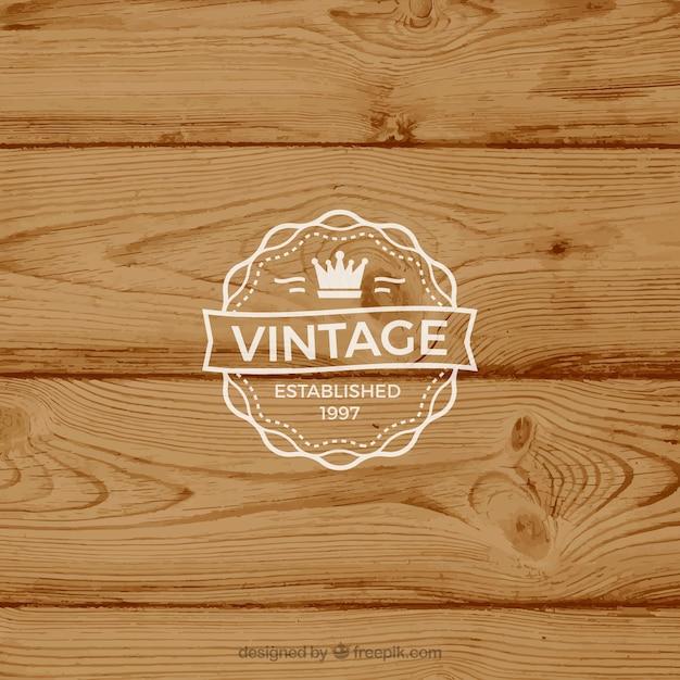 Retro-label op rustieke achtergrond Gratis Vector