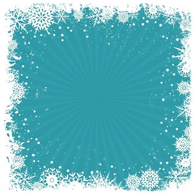Retro sneeuwvlokken frame op een blauwe achtergrond Gratis Vector