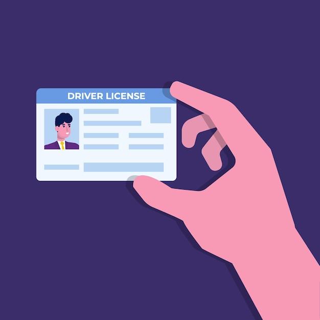 Rijbewijs van de auto in de hand met de identiteitskaart. Premium Vector