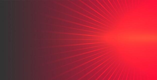 Rode achtergrond met gloeiende stralen die naar voren komen Gratis Vector