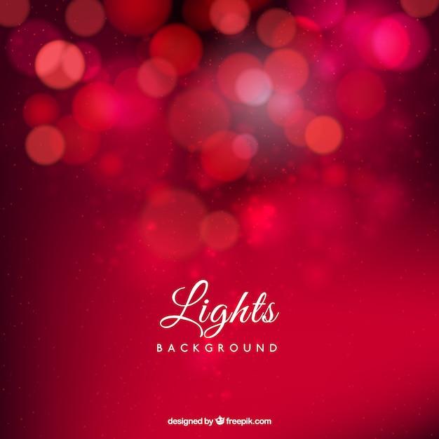 Rode achtergrond verlichting Gratis Vector