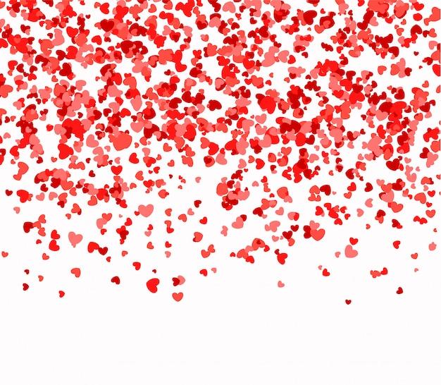 Rode en roze harten uit de lucht vallen Premium Vector