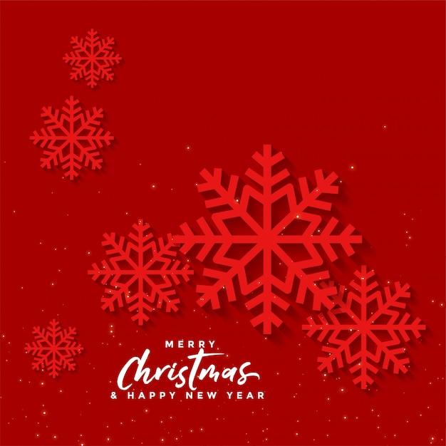 Rode kerstmisachtergrond met sneeuwvlokken Gratis Vector