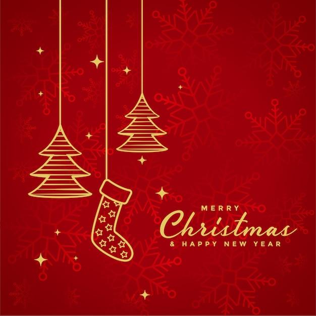 Rode merry christmas achtergrond met kerst elementen Gratis Vector