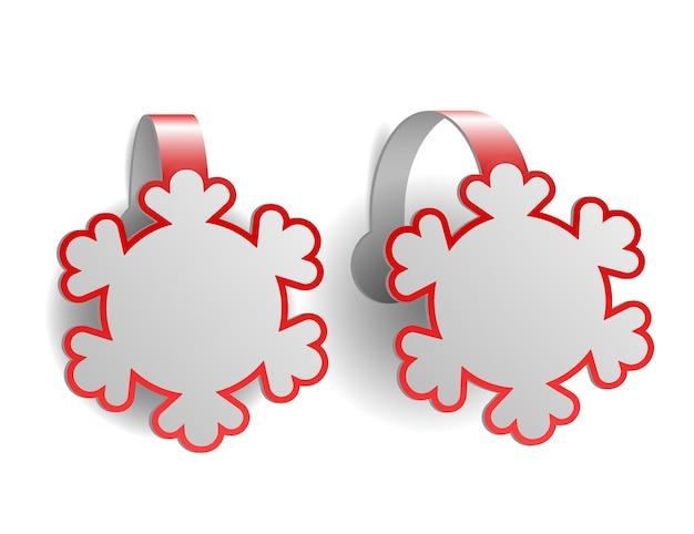 Rode reclamewobblers in de vorm van sneeuwvlokken die op wit worden geïsoleerd Premium Vector