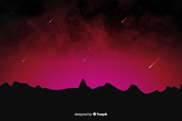 Rode tinten van een nacht met vallende sterren Gratis Vector