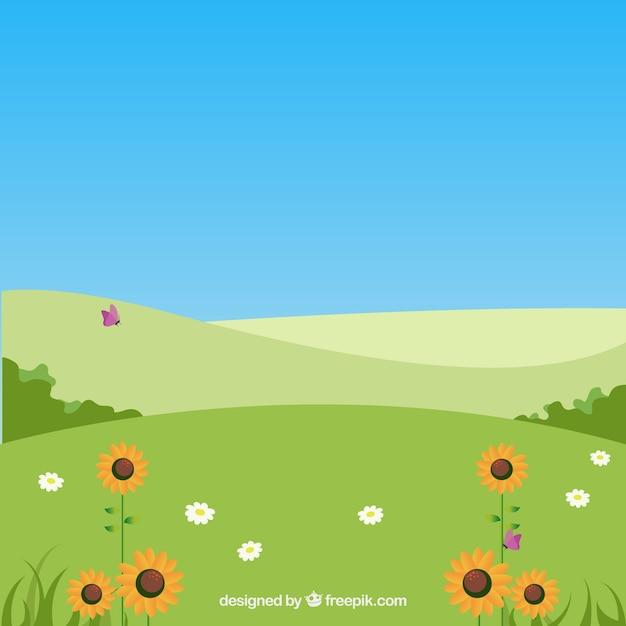 Rolling klif landschap met zonnebloemen Gratis Vector