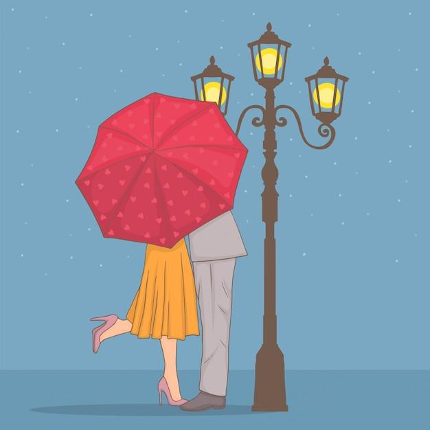 Romantisch paar onder een rode paraplu Premium Vector