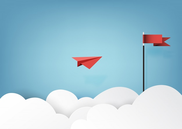 Rood document vliegtuig dat aan rode vlag op blauwe hemel en wolk vliegt. Premium Vector