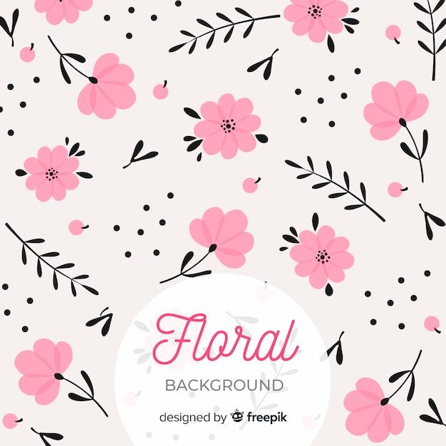 Roze en zwarte platte bloemenachtergrond Gratis Vector