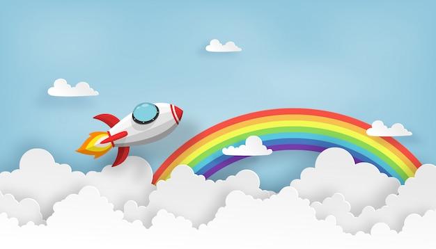 Ruimteschip of raketlancering in de hemel over de wolken en de regenboog. Premium Vector