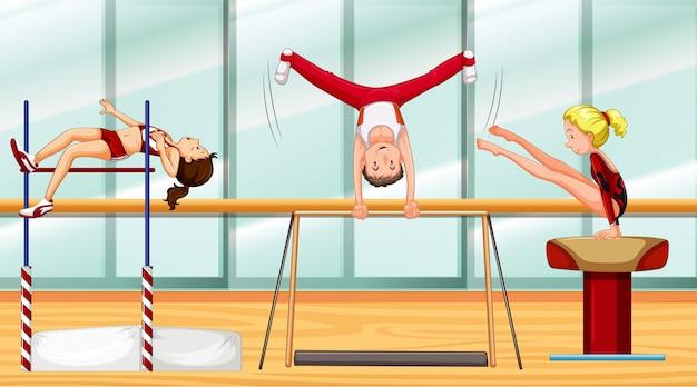 Scène met drie atleten gymnastiek doen Premium Vector