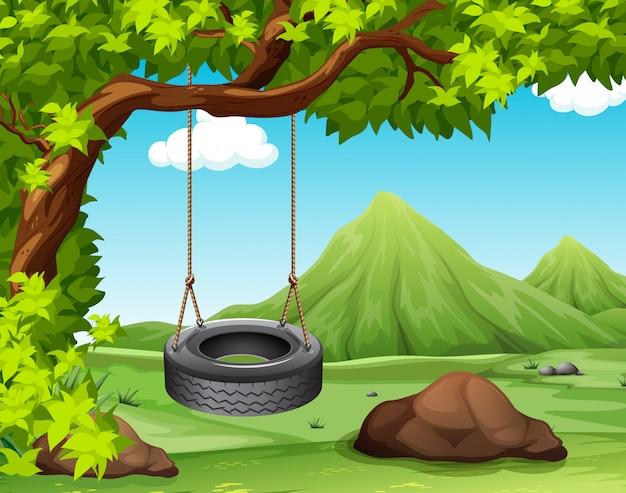 Scène met schommeling op de boom Gratis Vector