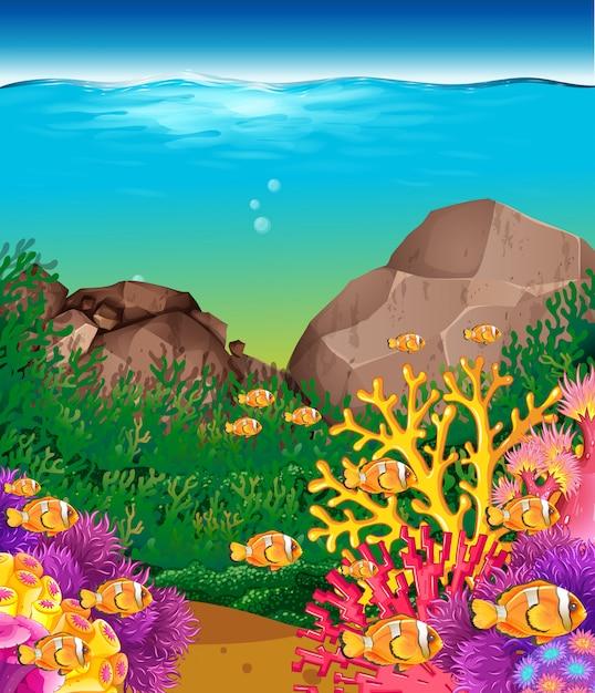 Scène met vissen onder de oceaanachtergrond Gratis Vector