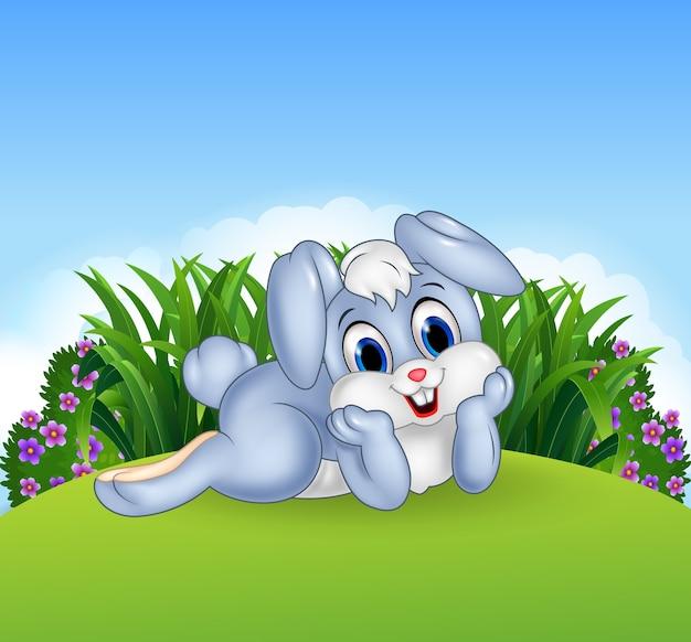Schattig konijntje liggen in de jungle Premium Vector