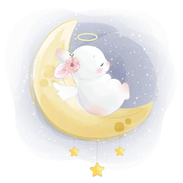 Schattige baby konijntje slapen op maan Premium Vector