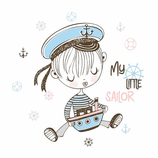 Schattige kleine matroos jongen in cap met speelgoed boot. Premium Vector