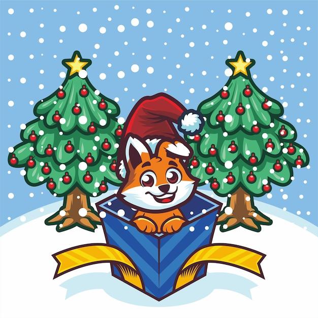 Schattige kleine vos uit geschenkdoos met kerstmis Premium Vector