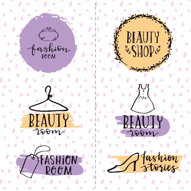 Schoonheid handgetekende logo set Gratis Vector