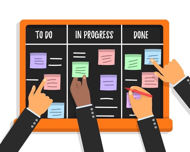 Scrum-taakbordconcept met handen met kleurrijke kleverige papieren Premium Vector