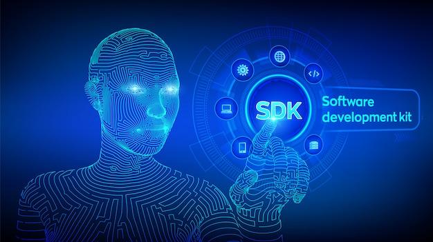 Sdk. software ontwikkeling kit programmeertaal technologie op virtueel scherm. technologie. wireframed cyborghand wat betreft digitale interface. ai. illustratie. Premium Vector