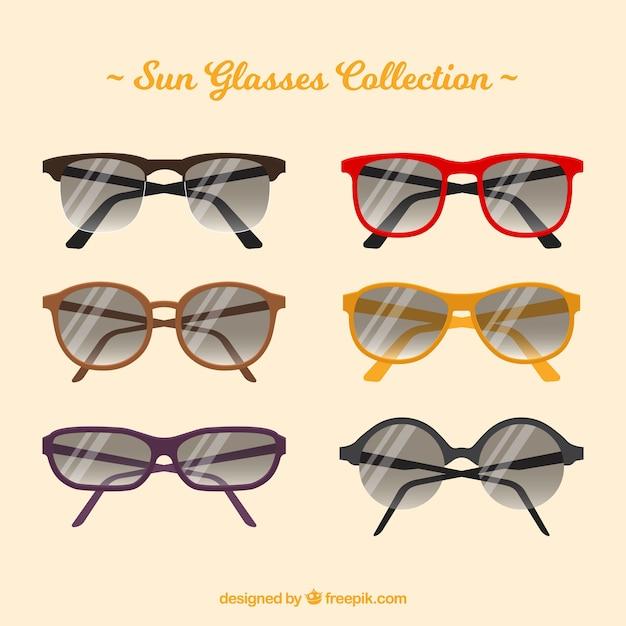 Seizoensgebonden zonnebrilcollectie in platte lenzen Gratis Vector
