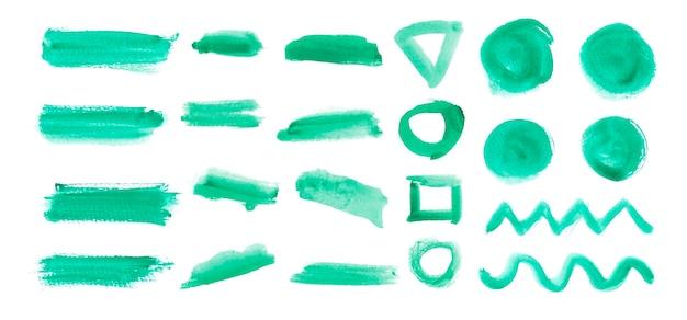Set geborstelde elementen in groene aquarel Gratis Vector