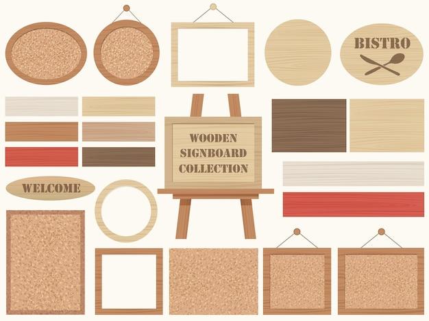 Set houten uithangborden en frames geïsoleerd op een vlakte Gratis Vector