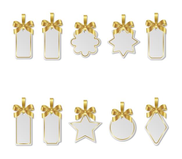 Set kerst witte prijskaartjes met gouden bogen Premium Vector