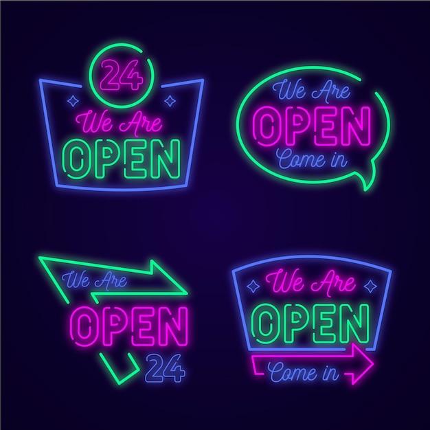 Set neonlichten met we zijn open borden Gratis Vector
