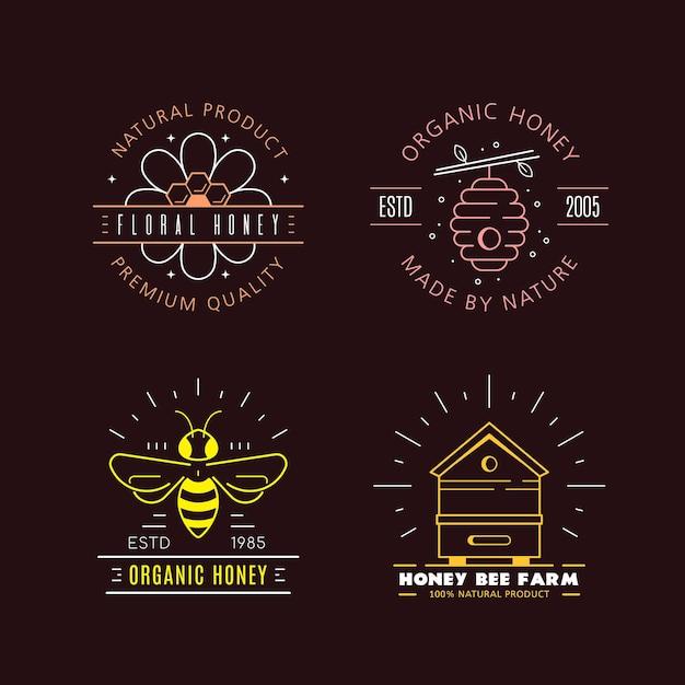 Set overzichtsjablonen logo ontwerp. biologische en eco-honingetiketten die op zwarte achtergrond worden geïsoleerd. honingproductiebedrijf, honingpakket. Premium Vector
