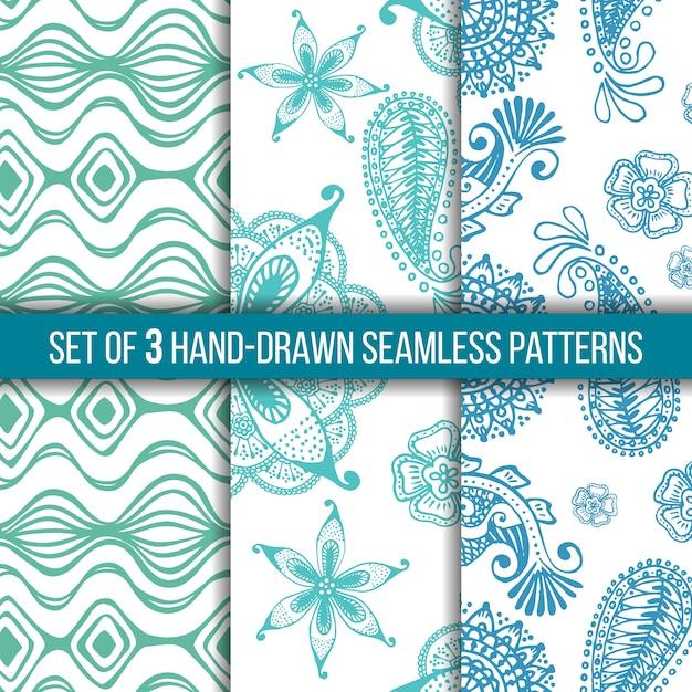 Set van 3 hand getrokken naadloze indiase patronen op een witte achtergrond, doodles. Premium Vector
