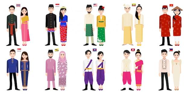 Set van aziatische mannen en vrouwen stripfiguren in klederdracht met vlag Premium Vector