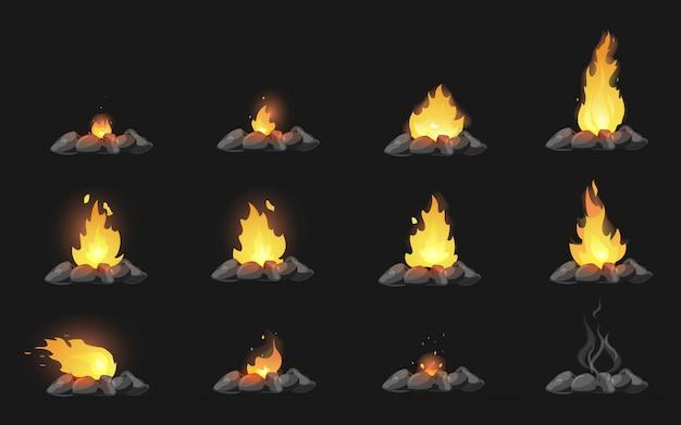 Set van cartoon vreugdevuren met stenen op zwarte achtergrond Premium Vector