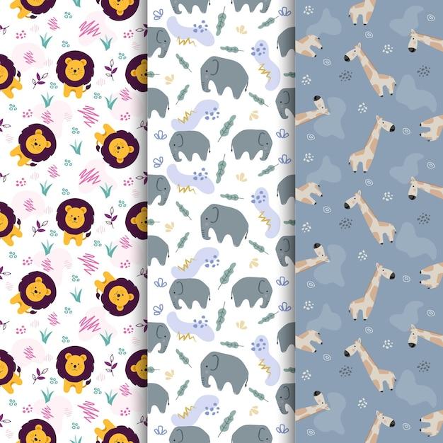 Set van dierlijke leeuw olifant giraffe cute cartoon naadloze patroon Premium Vector