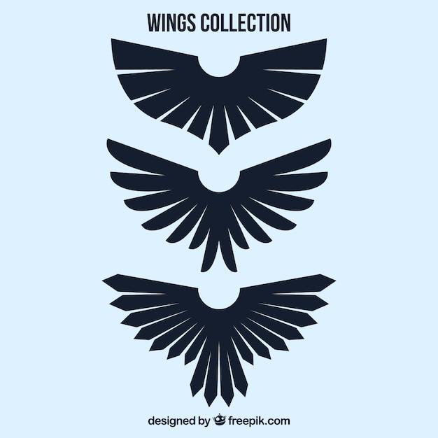 Set van drie zwarte decoratieve vleugels Gratis Vector