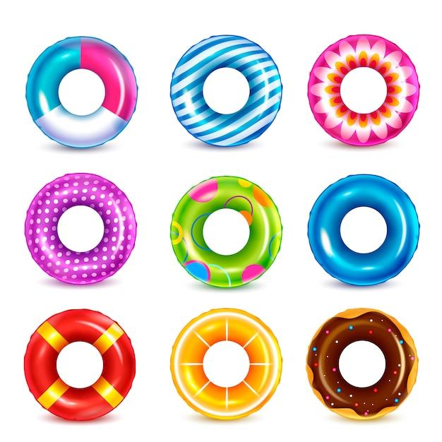 Set van geïsoleerde kleur opblaasbare rubberen zwemmen ringen realistische afbeeldingen met kleurrijke patroon op lege achtergrond Gratis Vector