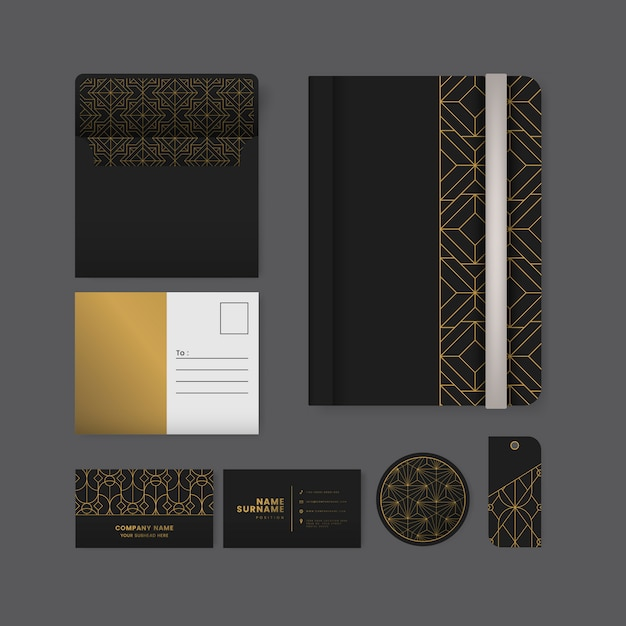 Set van gouden geometrische patroon op zwart oppervlak briefpapier Gratis Vector