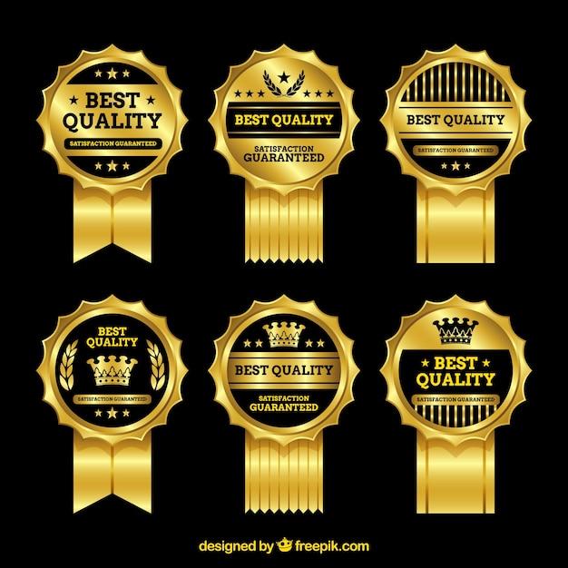 Set van gouden premium badges Gratis Vector