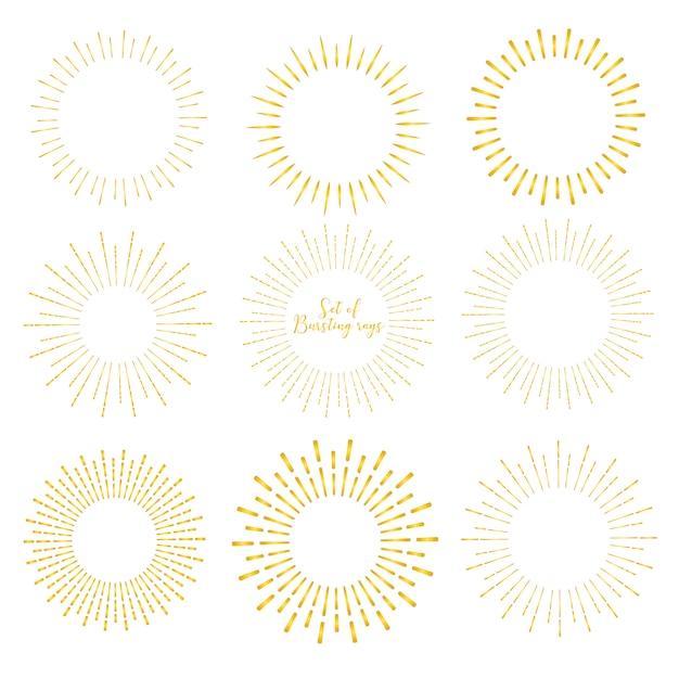 Set van gouden sunburst stijl geïsoleerd op een witte achtergrond. Premium Vector